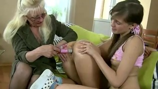 Old lesbian teacher plays with her teen students' shaved pussies