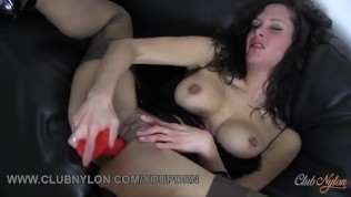 Dirty brunette slut with big boobs fucks toy in fully fashioned nylon stockings and black lingerie