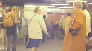 Girl walks topless trough metro station