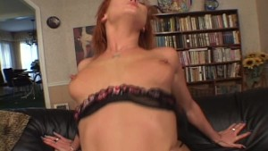 Red head strips for her man