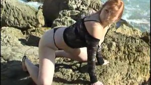 Eva in black panties on the rocks