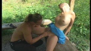 Blonde beauty takes a walk in the woods 2/4