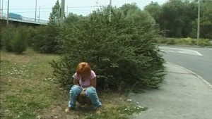 sweet red heat girl peeing in public