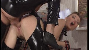Hot black plastic dressed couple know how to turn up the heat