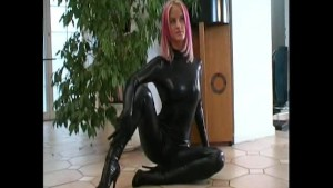 Redhead Cynthia in shiny black dress