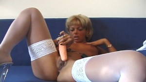 Sexy blonde lady strips and plays with herself