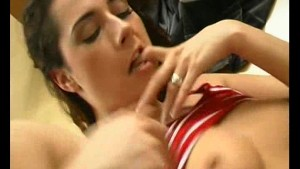 A girl enjoys getting her face plastered with cum