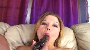 Sucking and inserting a big BLACK dildo