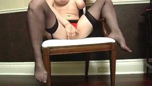 Horny girl wears her black stockings while playing with herself