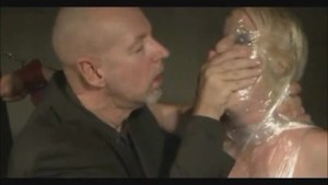 Bound girl gets wrapped in plastic