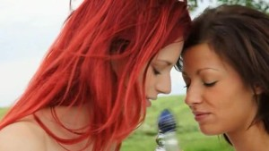 Redhead and blackhair babes in the grass