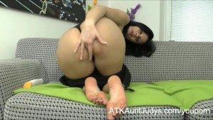 Milf Jana plays with her hairy pussy