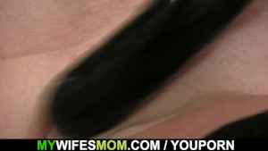 Lewd mother-in-law toying her shaved cunt then takes his cock