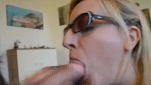 Blonde MILF sucking a huge dick and gets a big facial