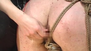 Asian slavegirl moans during a nasty treatment