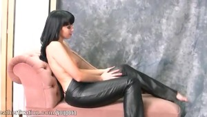 Naked babe loves the feel of tight leather pants around her big juicy ass