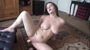 Jennifer strips and masturbates her pussy