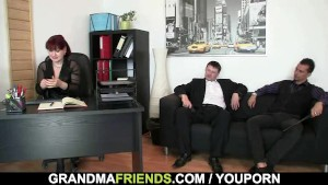 Mature office lady pleases two cocks