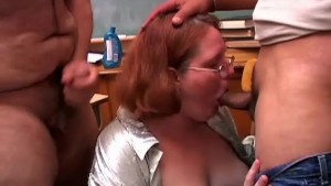Cute chubby redhead sucks two cocks at the same time