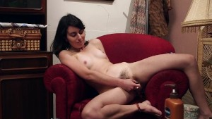 Charming amateur girl toys her hairy cunt