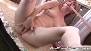 Redheaded milf Amber Dawn masturbates outdoors