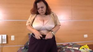So horny latin granny masturbates with two toys