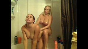 Two curvy girls play with each other in shower