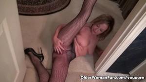 American milf Sally Steel gets naughty in fishnets