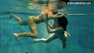 Two sexy amateurs showing their bodies off under water