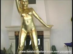 Golden bizarre bodypainting