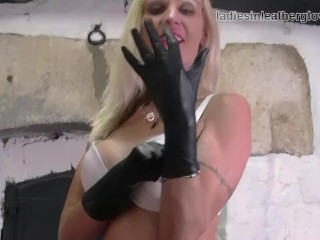 Blonde Milf Amy Lays On Forearm Length Leather Gloves Strips Of White Lingerie And Fingering Pussy In Fishnet Stockings And Boots