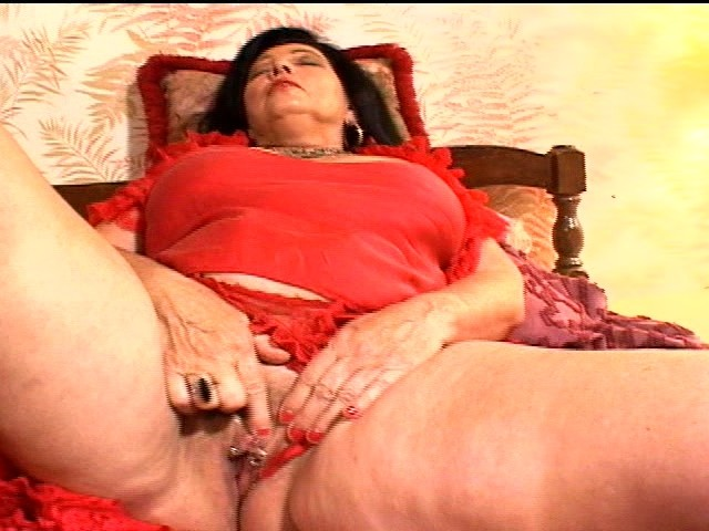Granny Fingers Her Pussy