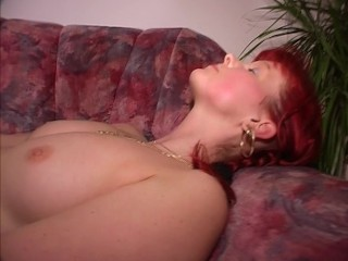 Raven haired cutie gently massages herself