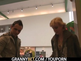 Blonde granny jumps on young cock - 3