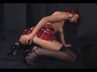 Redhead masturbates in sheer stockings and heels - 16
