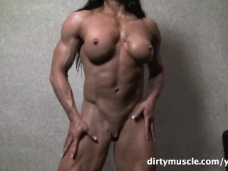 Muscular Brunette Plays With Her Big Clit