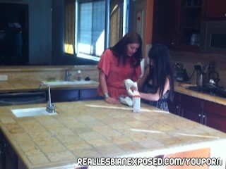 Horny milf eats teen pussy in the kitchen main image