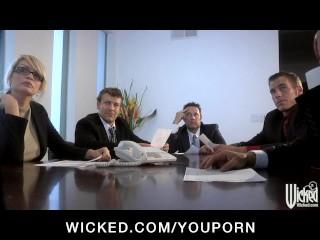 Busty redhead secretary slut deep-throats dicks in office orgy