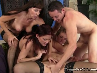 Lustful Housewives Pounce On Younger Man's Dick