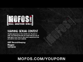 Big-tit brunette Megan Jones inserts objects into her wet pussy
