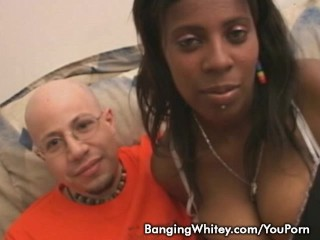 Busty black babe Amore sucking white cock and get banged hard