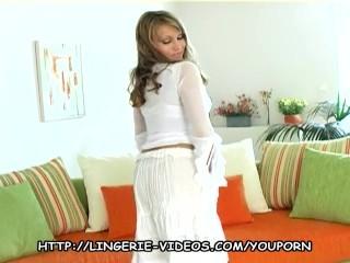 Blonde teases in stockings panties and high heels