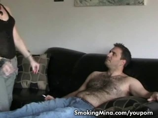 Hot brunette getting eaten out while smoking