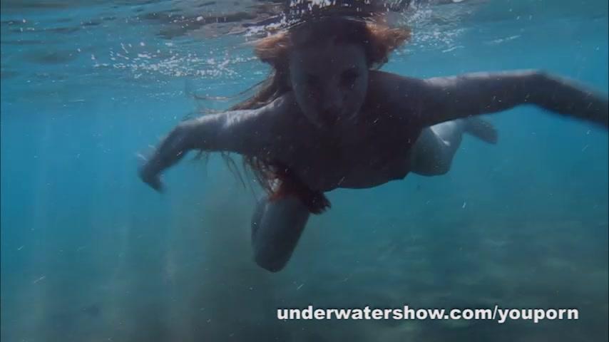 Nude women swimming underwater