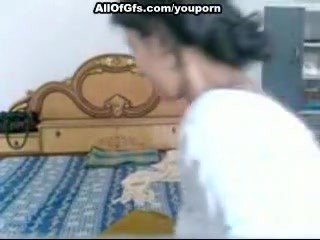 Girl masturbates while talking on the phone