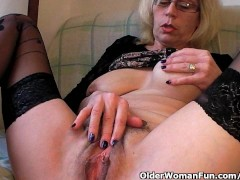 Picture Perverted granny pushes her fist up her old...