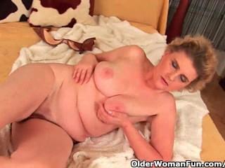 Grandma with massive breasts plus unshaven twat is dildoing