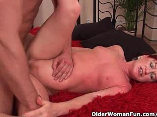 Red scortching hot grandma accumulates her skinny knockers covered in cum