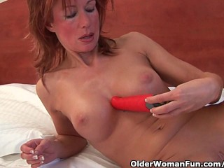 Sultry grandma probes her feeble cunt with a fuck toy