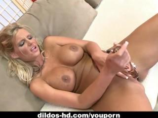 Phoenix Marie fucks herself with a glass dildo